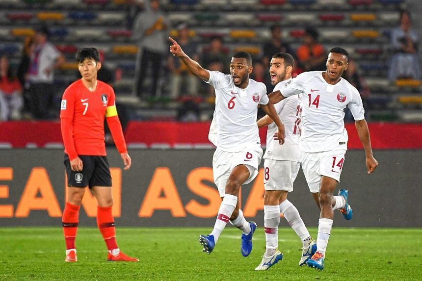 Qatar's Abdulaziz Hatem (No. 6) celebrating his goal against South Korea during their 1-0 Asian Cup quarter-final win yesterday, as Korean captain Son Heung-min can only look on. The goal was enough to see the Qataris progress to the last four at the