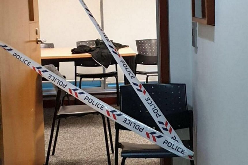 A photo of the group study room at the Singapore Management University School of Economics cordoned off with police tape was circulating online on Jan 8, 2019.