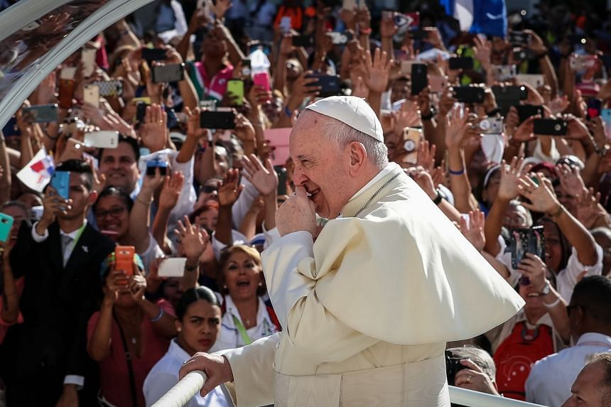 Pope Francis waves as he arrives to lead mass at Santa Maria la Antigua Cathedral in Panama City.
