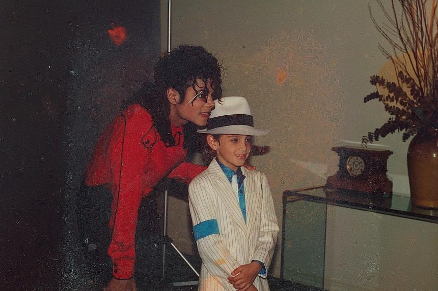 Singer Michael Jackson with an unidentified boy in a still from Leaving Neverland, which details the extent of the abuse of two men, who were then minors, with explicit and graphic accounts.