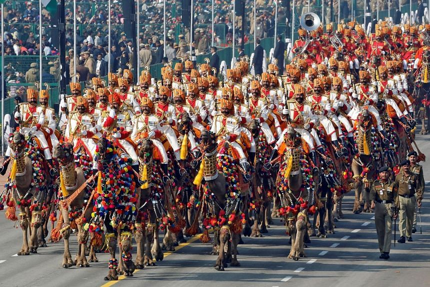 Indian Border Security Force (BSF) soldiers riding their camels during yesterday's Republic Day parade in New Delhi. Large crowds thronged the parade, which featured a cultural extravaganza of dances and gymnastics, colourful floats from Indian state