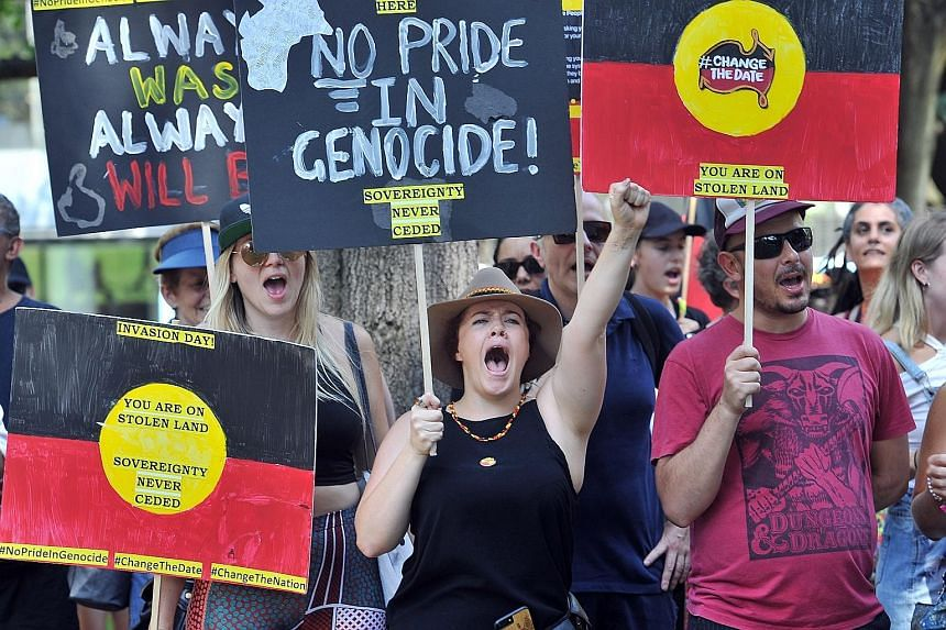 """Protesters shouting slogans while marching through the streets of Sydney yesterday at an """"Invasion Day"""" rally. Thousands joined rallies across Australia calling for an end to the celebration of Australia Day on Jan 26, which marks the declaration of"""