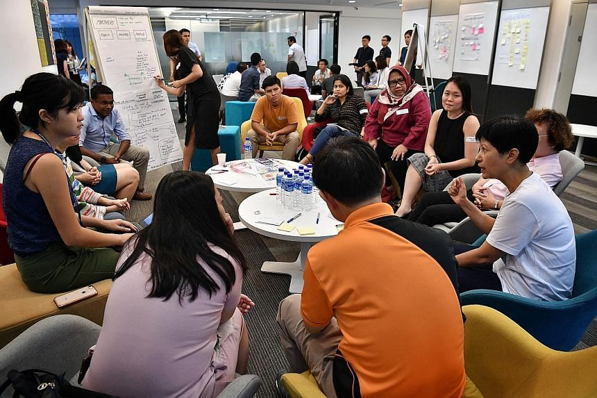 Second Minister for Education Indranee Rajah (at right) making a point at a session held by Uplift at the Ministry of Education in Buona Vista. The discussion included community strategies to tackle long-term absenteeism.