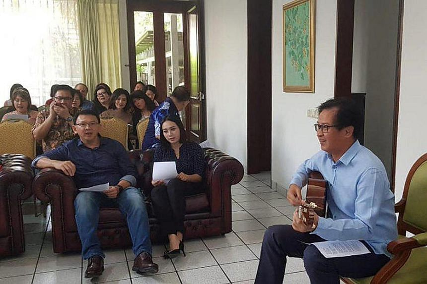Former Jakarta governor Basuki Tjahaja Purnama (left), with his girlfriend Puput Nastiti Devi seated next to him, at a thanksgiving service after being released from prison on Thursday in this photo taken by Antara Foto.