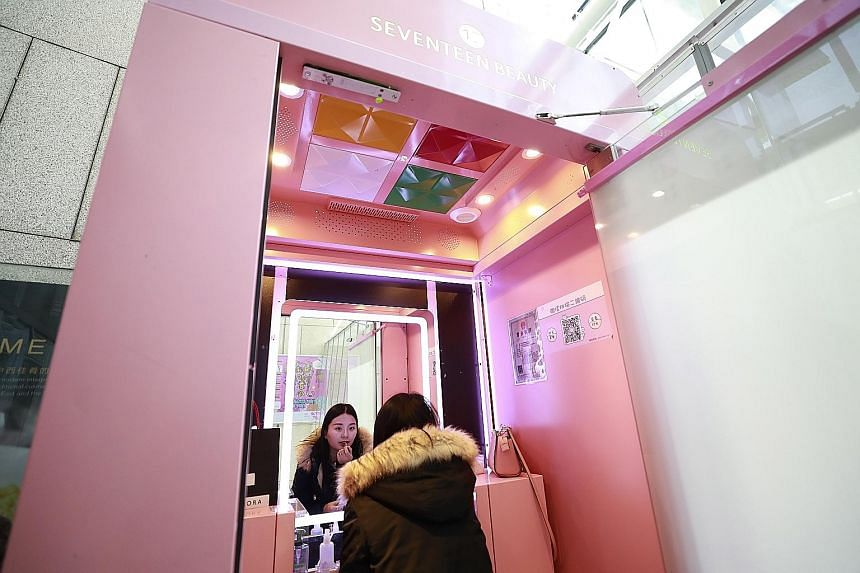 "Chinese customer Fu Jie, 28, trying out make-up in a ""shareable make-up"" pod operated by 17Beauty, or Seventeen Beauty, at a mall in Beijing. Such pods are the latest fad to enter China's large sharing economy, aimed at young urban women on the go. C"