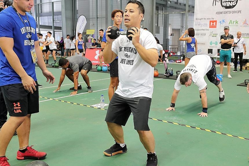 Minister for Social and Family Development Desmond Lee joined 700 other participants yesterday morning for a workout session at The Arena in Our Tampines Hub. The fitness charity event, organised by Operation Broken Wing, was raising money for the Si