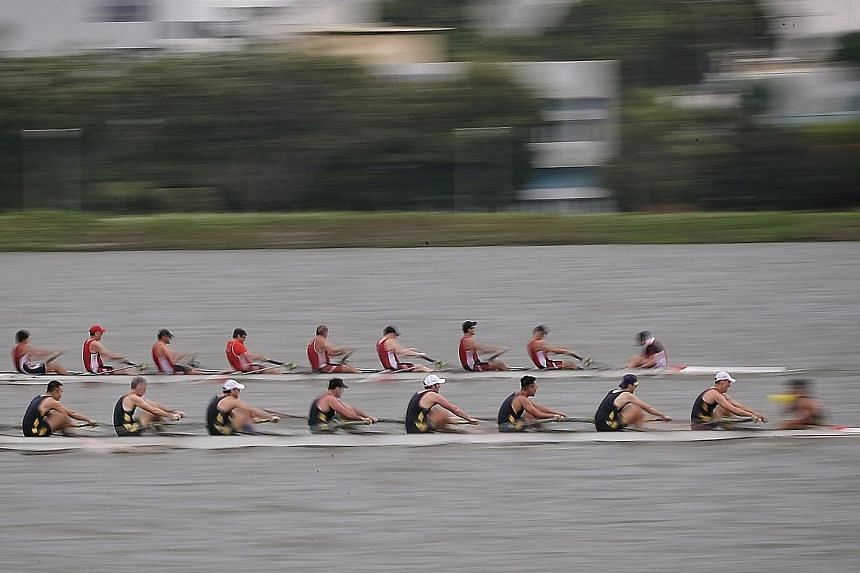 Royal Hong Kong Yacht Club (in black) pipping Singapore's Easter Rowing Club to first place in the Open men's eight at Pandan Reservoir yesterday. The race was part of the 3-Way Regatta, the first inter-club event launched by Easter and in collaborat