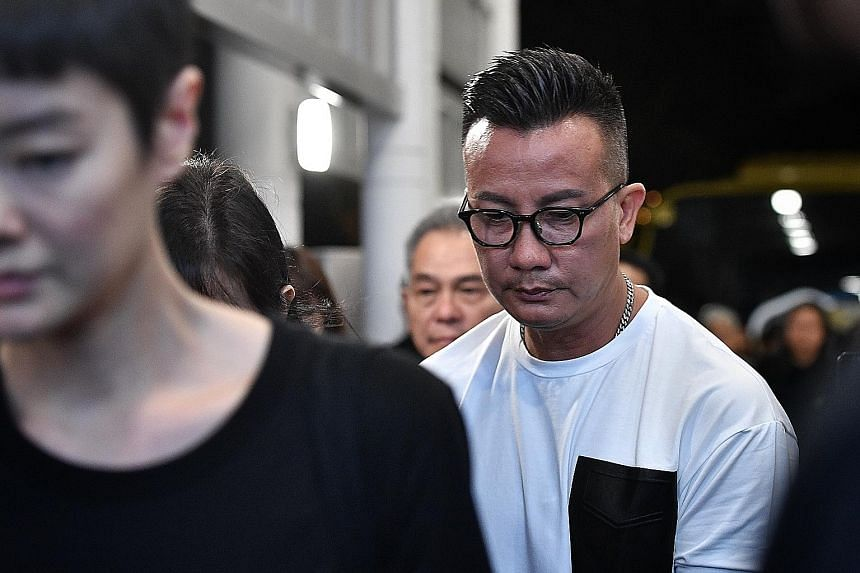 Also spotted among the mourners were celebrities Christopher Lee (centre) and Fann Wong (beside him). From right: Actors Xu Bin and Ian Fang, close friends of Mr Pang, at the wake. Actress and model Sheila Sim (left) and actor Chen Hanwei arriving at