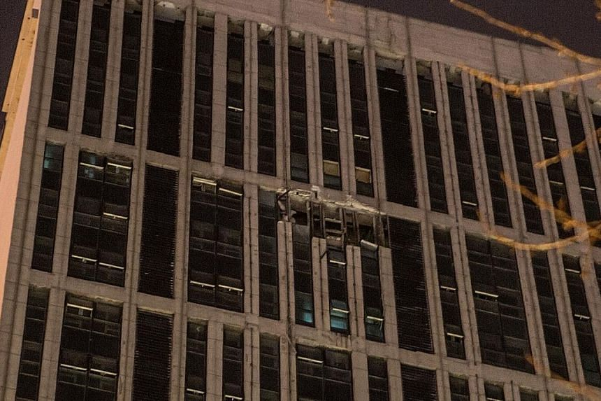 Broken windows of Wanda Plaza after an explosion in Changchun city, Jilin province, on Friday.