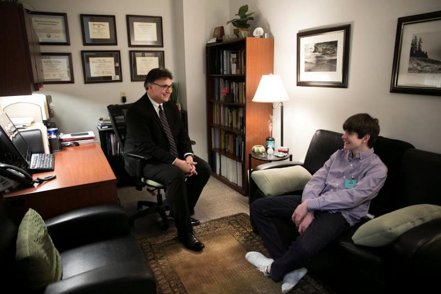 "Dr. Chris Tuell, Clinical Director of Addiction Services, poses with Danny Reagan at the Lindner Center of Hope's ""Reboot"" program, the first of its kind to admit only children who suffer from compulsion or obsession with their use of technology, in"