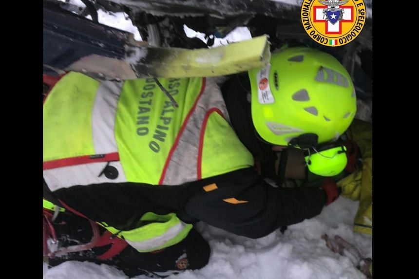 A rescue worker at the site of the aerial tragedy on the Rutor glacier.
