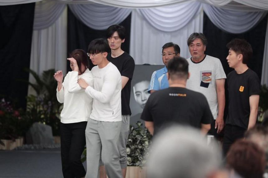 Mr Aloysius Pang's parents (mother is in white top; father is second from right) were distraught as they arrived at around 11.30am on Jan 27 with other family members. Mrs Pang is being held by Jefferson Pang, Aloysius' eldest brother.