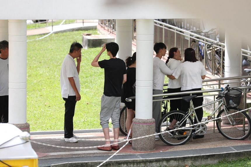 Members of Mr Pang's family outside the wake in MacPherson on Jan 27, 2019.