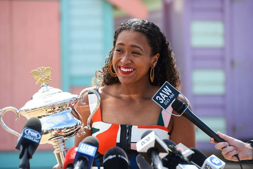 Naomi Osaka speaking to the media while holding the championship trophy at Brighton Beach in Melbourne on Jan 27, 2019, a day after she won the Australian Open.