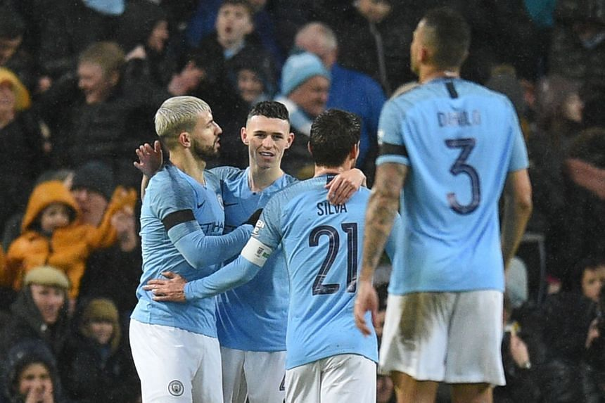 Manchester City's Sergio Aguero (left) celebrates scoring their fifth goal from the penalty spot.