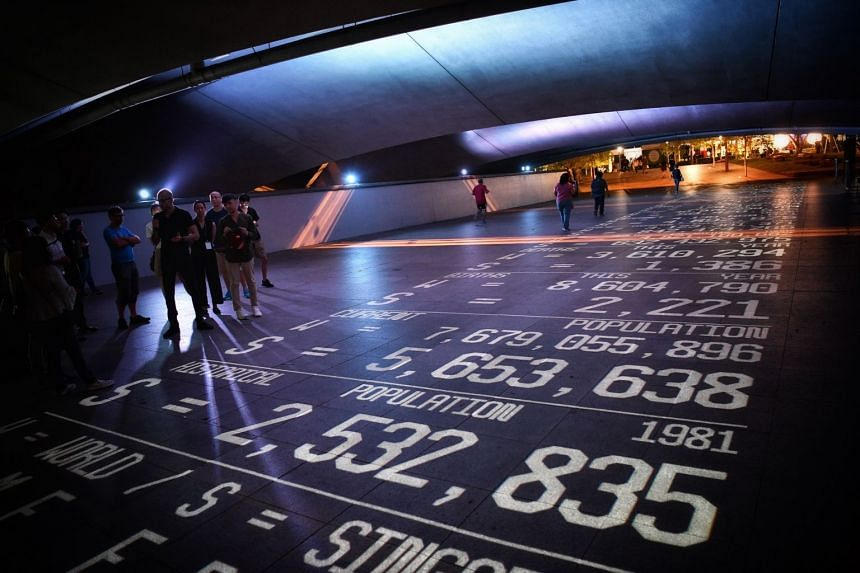 TIME FRAME by Donis is a carpet of information occurring in real time, projected under Esplanade Bridge..