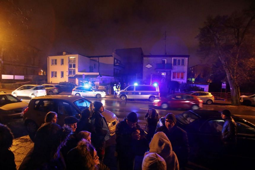 Police cars seen at the site of a fire which broke out in an escape room in Koszalin, Poland, on Jan 4, 2019.