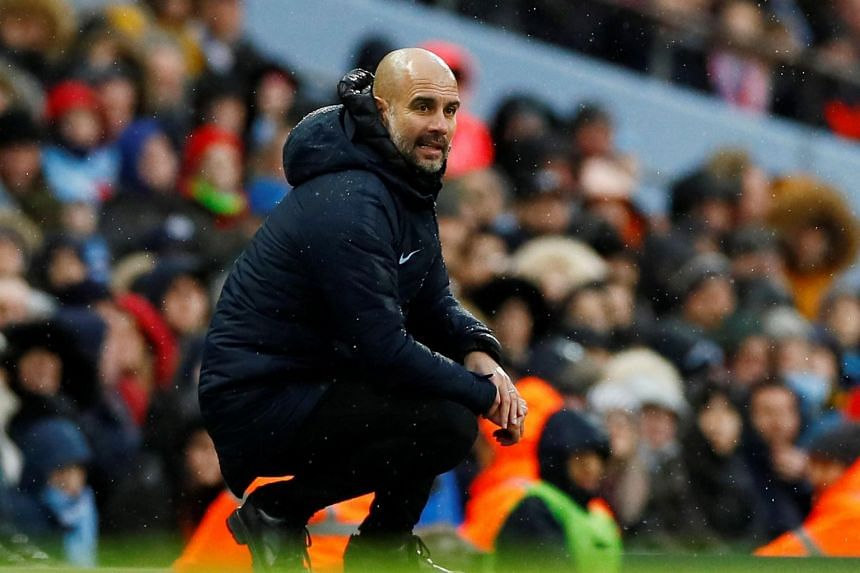 Manchester City manager Pep Guardiola looks on during the match between Manchester City and Burnley at the Etihad Stadium in Manchester, Britain, on Jan 26, 2019.