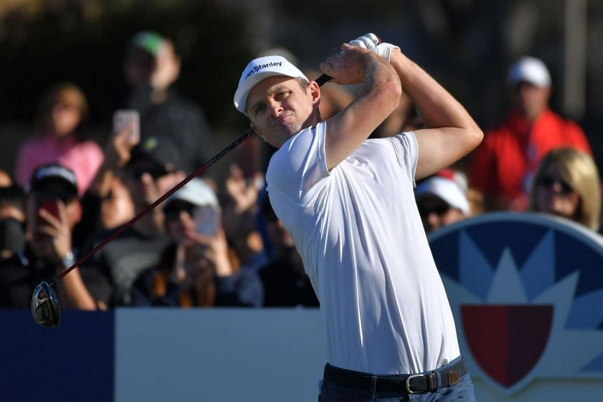 England's Justin Rose plays his shot during the third round of the the 2019 Farmers Insurance Open at Torrey Pines Golf Course in San Diego, California, on Jan 26, 2019.