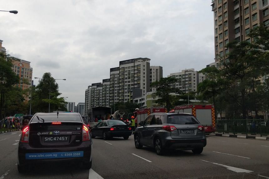 Two fire engines were among the eight Singapore Civil Defence Force vehicles deployed to the scene. PHOTO: JERIEL LIM