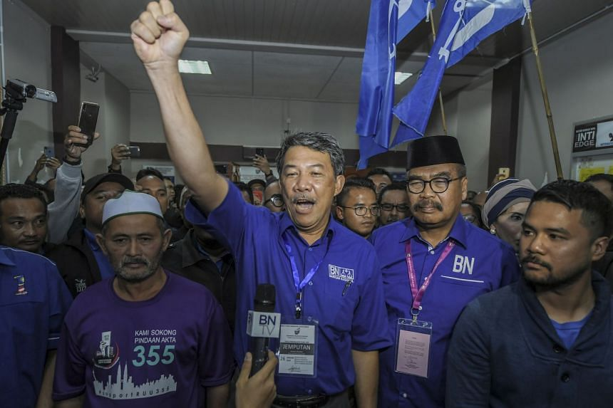 Victorious BN candidate Ramli Mohd Nor (second from right), who is poised to become Malaysia's first Orang Asli MP, with Umno acting president Mohamad Hasan (centre), after winning the Cameron Highlands polls yesterday. For the BN coalition, which