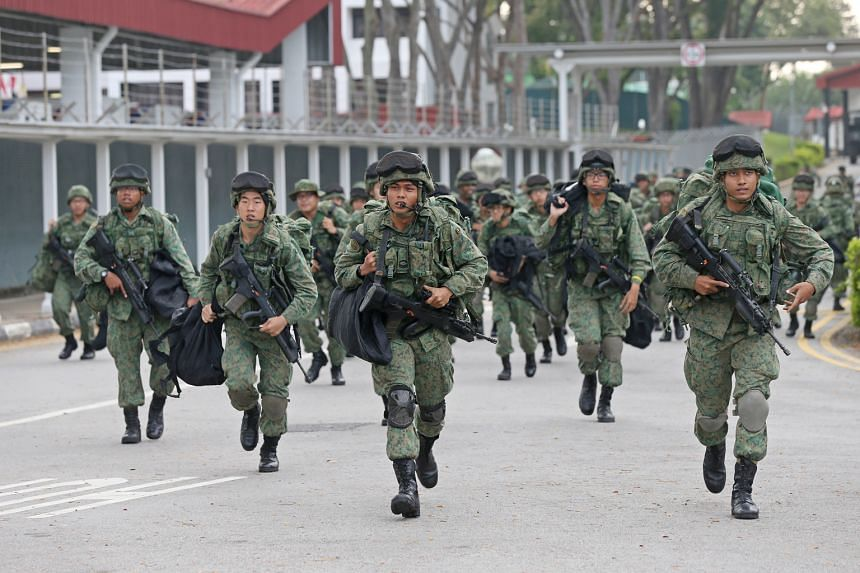 SAF regulars and NSmen taking part in an open mobilisation exercise last year. Observers are confident that NSmen are competent and qualified.