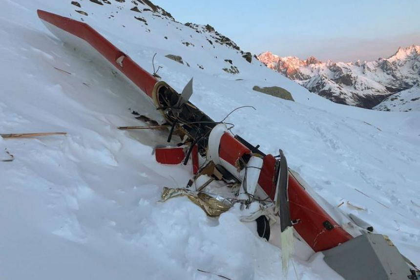 The wreckage of a light private plane after it collided with a helicopter above the Rutor glacier, close to La Thuile, northwestern Italian Alps, on Jan 25, 2019.