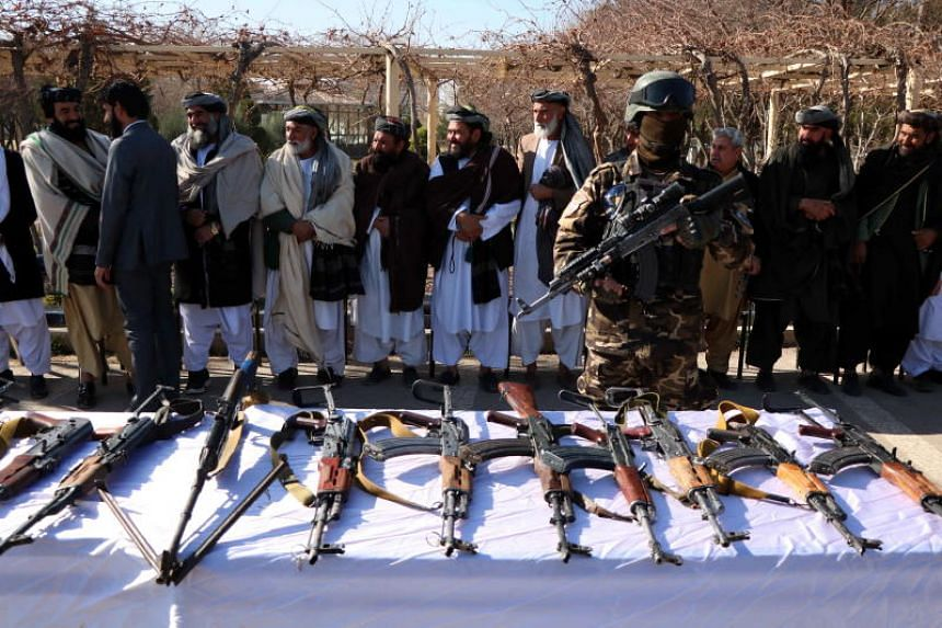 Former insurgents surrendering their weapons during a reconciliation ceremony in Herat, Afghanistan, on Jan 23, 2019.