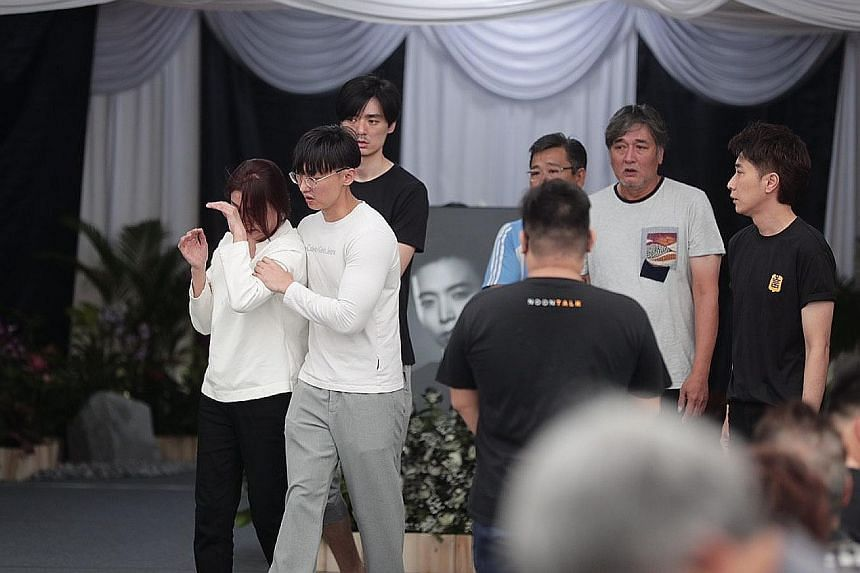 Actor Aloysius Pang's mother with other family members at his wake yesterday in MacPherson Lane. Mr Jefferson Pang, the actor's eldest brother, said in his eulogy that their mother doted on Aloysius a lot because he was the youngest.