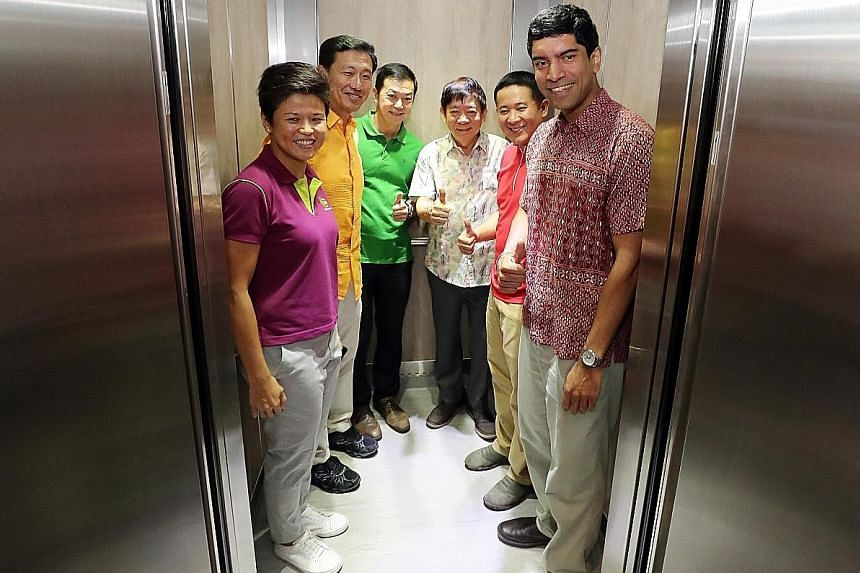 Sembawang GRC MPs (from second from left) Ong Ye Kung, Lim Wee Kiak, Khaw Boon Wan, Amrin Amin and Vikram Nair in a new lift at Block 772 Woodlands Drive 60 yesterday. With them is Ms Poh Li San, assistant secretary of Sembawang Citizens' Consultativ