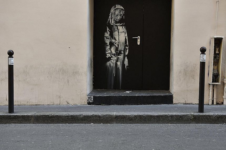 The stolen artwork by street artist Banksy on an emergency door at the Bataclan theatre in Paris, where a terrorist attack killed 90 people on Nov 13, 2015.