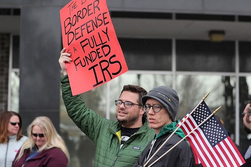 US Internal Revenue Service (IRS) employees protesting earlier this month against the US partial government shutdown. The 35-day shutdown, which ended last Friday, has taken its toll on several key US agencies, including the IRS and the Bureau of Eco