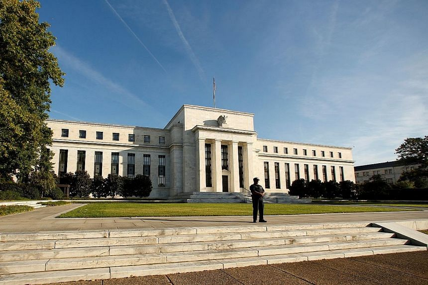 The US Federal Reserve building in Washington. While futures markets are betting on the Fed standing pat this year, economists suggest the key lending rate could be raised as soon as spring.