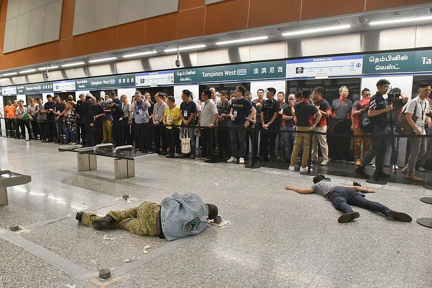 A gunman and a suicide bomber, both role players, lying dead on the floor at the platform of Tampines West MRT station where anti-terror drill Exercise Quicksand was held yesterday.