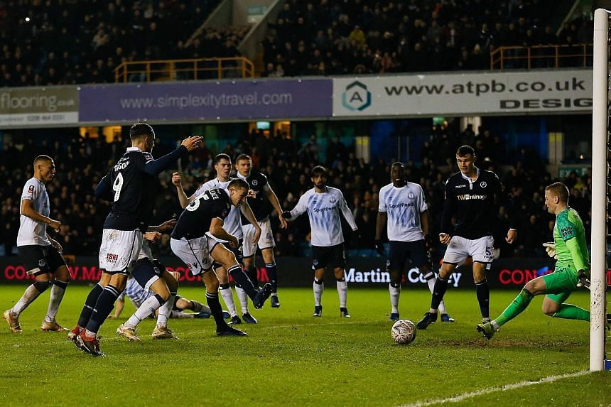 Millwall's Murray Wallace scoring the winner past goalkeeper Jordan Pickford in their 3-2 victory over Everton in the FA Cup fourth round at The Den on Saturday.