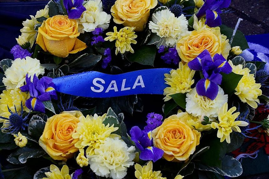 Tributes left outside Cardiff City Stadium for Emiliano Sala, whose plane disappeared from the radar over the English Channel last week.