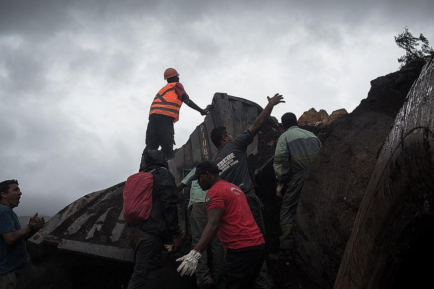 Rescue workers searching among the debris on Saturday for hundreds of people missing after a Vale dam burst near Brumadinho in Brazil's Minas Gerais state the day before, unleashing a torrent of mud and burying the miner's facilities and nearby homes