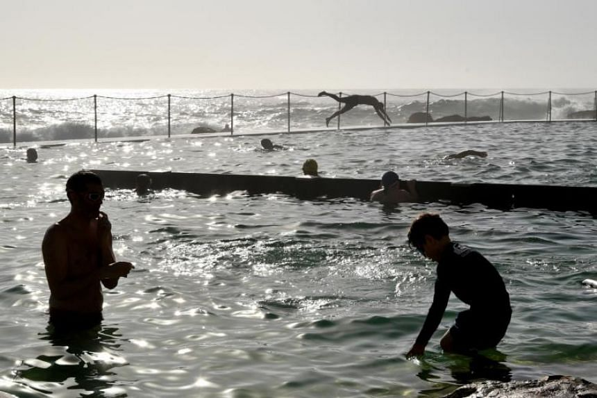 Beachgoers cool off at Bronte Beach in Sydney. While New Zealand's high temperatures were not likely to match Australia's last week, the increased heat drew attention to what people are accustomed to and the importance of how buildings are designed.