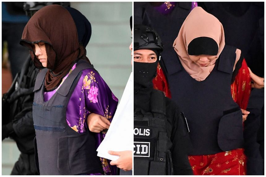 Vietnamese national Doan Thi Huong (left) and Indonesian national Siti Aisyah being escorted by Malaysian police after a special court session at the Shah Alam High Court, outside Kuala Lumpur on Dec 14, 2018.