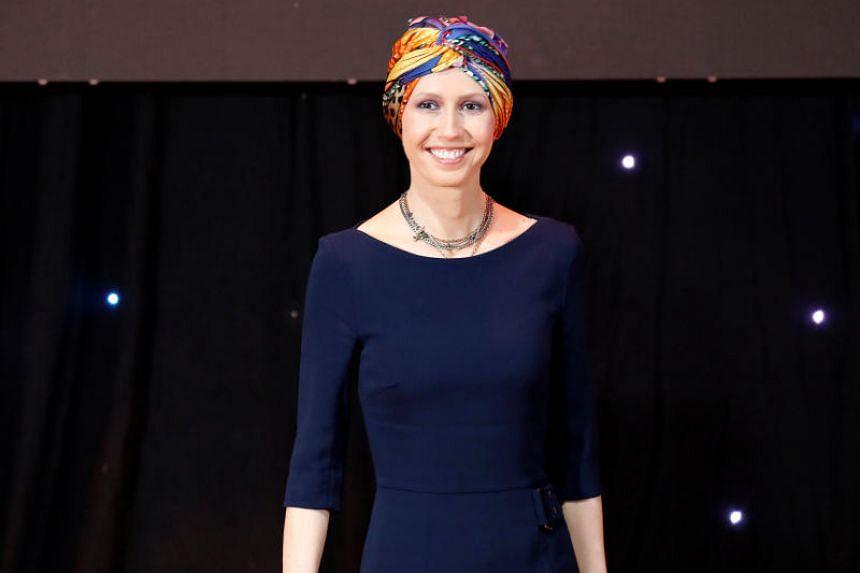 Asma al-Assad, wife of Syrian President Bashar al-Assad, at the graduation ceremony of professors from Damascus University, who will work at the Syrian Organisation for Persons with Disabilities, in Damascus, Syria, on Dec 3, 2018.