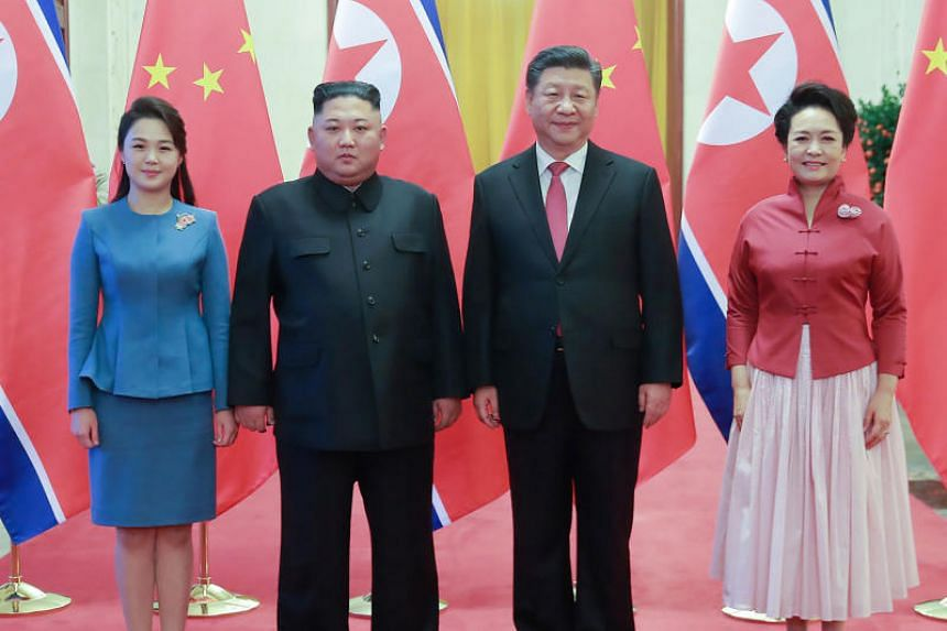 China's President Xi Jinping and his wife Peng Liyuan (both right) with North Korea's leader Kim Jong Un and his wife Ri Sol Ju (both left) at the Great Hall of the People in Beijing in early January 2019. Their two countries are boasting close ties