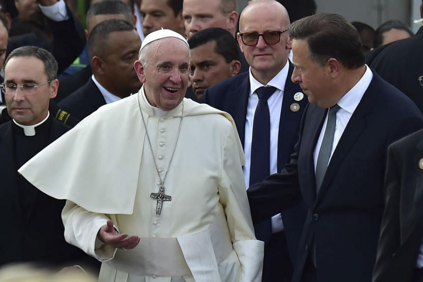 Pope Francis (left) talks with Panama's President Juan Carlos Varela upon landing at Tocumen International Airport in Panama City on Jan 23, 2019.