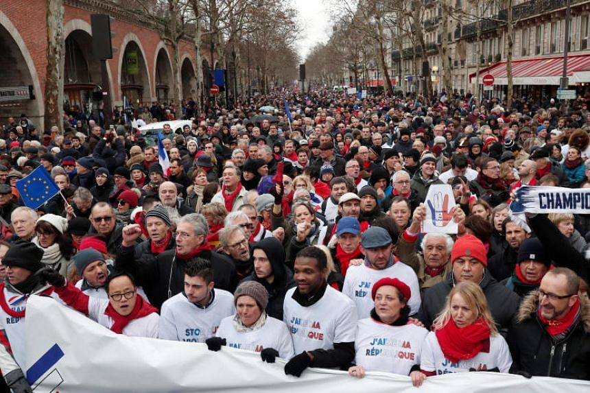 """Opponents to the """"yellow vests"""" violent behaviour, take part in a demonstration by the """"red scarves"""" movement in Paris, France, on Jan 27, 2019."""