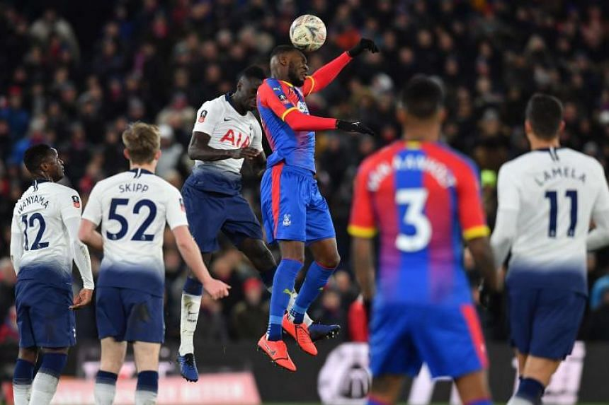 Tottenham Hotspur's Colombian defender Davinson Sanchez (third from left) and Crystal Palace's Zaire-born Belgian striker Christian Benteke (third from right) jump to head the ball during the English FA Cup fourth round football match at Selhurst Par