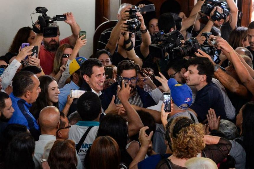 """Venezuela's National Assembly head and self-proclaimed """"acting president"""" Juan Guaido leaves after mass to honour the fallen in the fight for freedom, political prisoners and the exiled at the San Jose church in Caracas on Jan 27, 2019."""