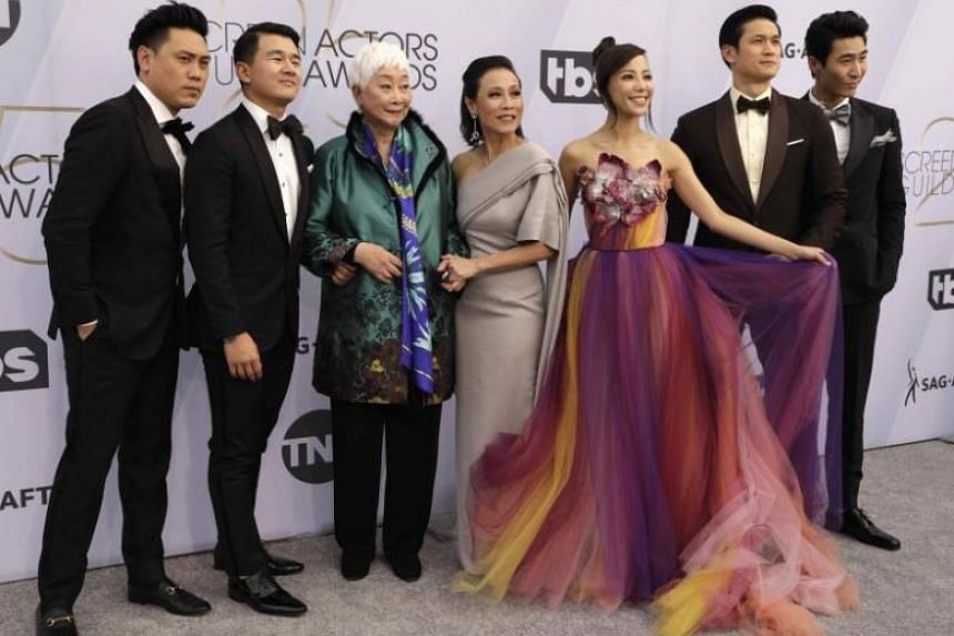 The cast of Crazy Rich Asians, including Singapore actresses Tan Kheng Hua and Fiona Xie (fourth and fifth from left), at the Screen Actors Guild Awards in Los Angeles on Jan 27, 2019.