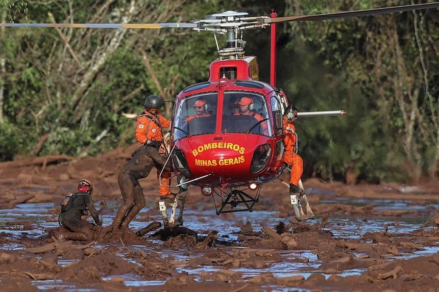 Firefighters participate in the search and rescue efforts of victims of the dam break in Brumadinho, municipality of Minas Gerais, Brazil, on Jan 27, 2019.