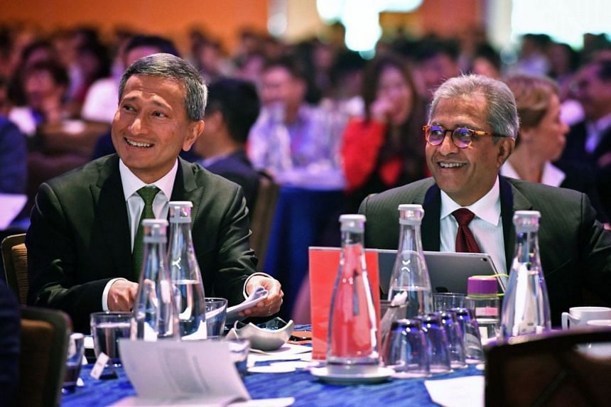 Foreign Minister Vivian Balakrishnan (left) and Janadas Devan, director of Institute of Policy Studies, smile after panellists shared a light-hearted moment at the Singapore Perspectives 2019 conference held by Institute of Policy Studies.