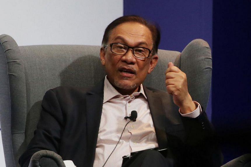 Mr Anwar Ibrahim said his Parti Keadilan Rakyat (PKR) party accepted the results and congratulated BN candidate Ramli Mohd Nor (not pictured) on his victory.