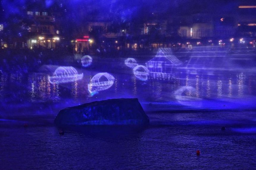 Multimedia show titled Bridges Of Time along Singapore river during the launch of the Singapore Bicentennial.